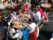 Skiers enjoy lunch outdoors Royalty Free Stock Image