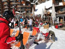 Skiers enjoy lunch outdoors in the sun Royalty Free Stock Photography