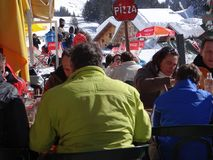Skiers enjoy an outdoor lunch Stock Image