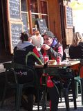 Skiers enjoy an outdoor lunch Stock Images