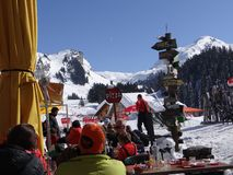 Skiers enjoy an outdoor lunch Royalty Free Stock Photo