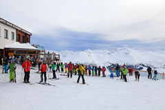 Skiers enjoy skiing at the slope in the Austrian Alps Royalty Free Stock Photos