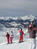 Skiers enjoy the sunny day Stock Images