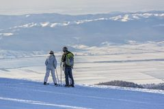 Skiers enjoying the panorama Royalty Free Stock Image