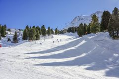 Skiers friends on mountain snow environment with blue clean sky. Background Royalty Free Stock Image