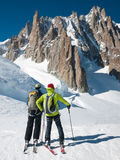 Skiers in front of the breathtaking view of Mont Blanc de Tacul. Two mountain touring skiers in front of the breathtaking view of Mont Blanc de Tacul, Mont Blanc Royalty Free Stock Photos