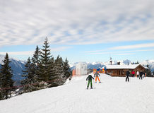 The skiers in front of small t-bar lift and cafe Stock Photography