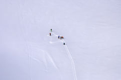 Skiers on the glacier in Alps Stock Images