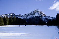 Skiers going down the slope Royalty Free Stock Image