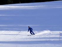 Skiers going down the slope Royalty Free Stock Photo