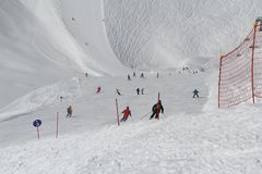 Skiers going down the slope at ski resort Stock Photography
