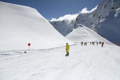 Skiers going down the slope at ski resort Stock Photo