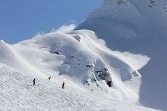 Skiers going down the slope at ski resort Royalty Free Stock Photos