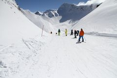 Skiers going down the slope at ski resort Royalty Free Stock Photography