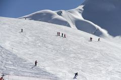 Skiers going down the slope at ski resort Royalty Free Stock Photo