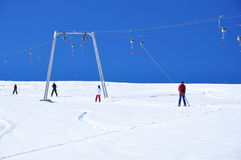 Skiers going up. On the ski lifter Stock Photo