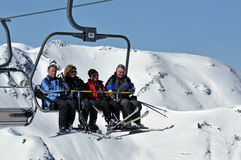 Skiers going up with ski lift Stock Photography