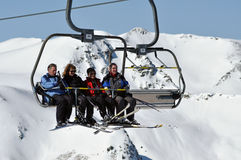 Skiers going up with a ski lift Stock Photo