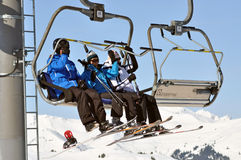 Skiers going up with a ski lift Royalty Free Stock Images