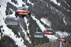 Skiers going up with a ski lift Stock Image
