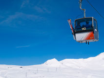 Skiers in Gondola Cablecar. Skiers being transported up ski slopes in Gondola Cablecar Stock Image