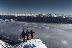 Skiers hike up a mountain Stock Image