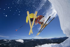 Skiers Launching Off Snow Bank Hitting The Slopes Stock Photos