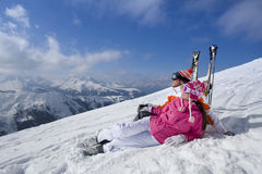 Skiers laying on mountain top looking at mountains Stock Photo