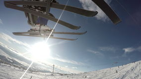 Skiers on the lift with great landscape bottom view stock video footage