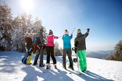 Skiers looking landscape on mountain. Back view Royalty Free Stock Images