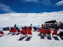 Skiers on the loungers of the Italian Alps. The Skiers on the loungers of the Italian Alps stock photo