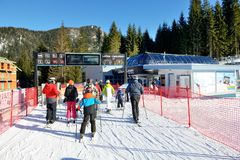 The skiers and Lucky-Vyhliadka cableway station in Jasna Low Tatras Royalty Free Stock Photos