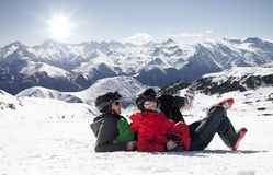 Skiers lying on snow in high mountains, Alps France Stock Image