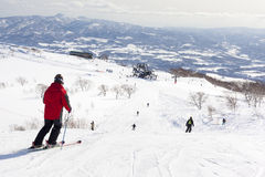 Skiers on Mount Niseko Annupri, Hokkaido, Japan Stock Photography