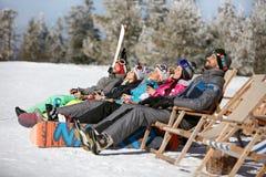 Skiers sunbathing in sunbed. Skiers on mountain sunbathing in sunbed Royalty Free Stock Photo