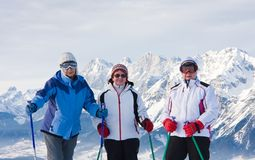 Skiers mountains in the background Royalty Free Stock Image
