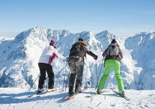 Skiers mountains in the background Royalty Free Stock Photos