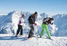 Skiers mountains in the background Royalty Free Stock Photo