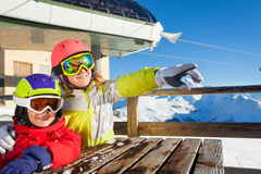 Skiers observing nature sitting at mountain cafe Royalty Free Stock Images