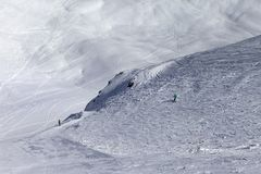 Skiers on off-piste slope in nice sun day Stock Photos
