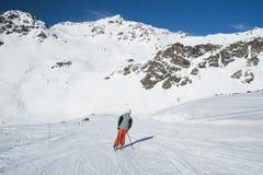 Skiers On A Piste In Alpine Ski Resort Stock Image