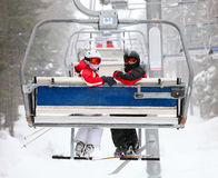 Free Skiers On A Ski-lift Royalty Free Stock Photography - 25188997