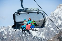 Free Skiers On A Ski Lift. Stock Photos - 37523323