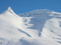 Skiers paradise. Ski tracked backcountry mountain Royalty Free Stock Photo