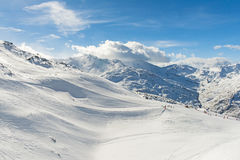 Skiers on a piste in alpine ski resort Royalty Free Stock Photography