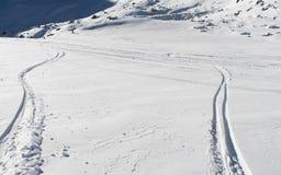 Skiers on a piste in alpine ski resort Royalty Free Stock Photo
