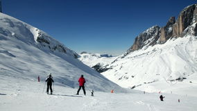 Skiers on a piste stock video