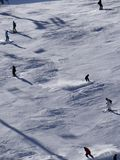 Skiers on piste in high Alpine ski area Stock Photography