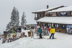 Skiers at Postavaru chalet Stock Image