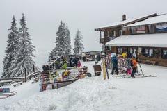 Skiers at Postavaru chalet Stock Image